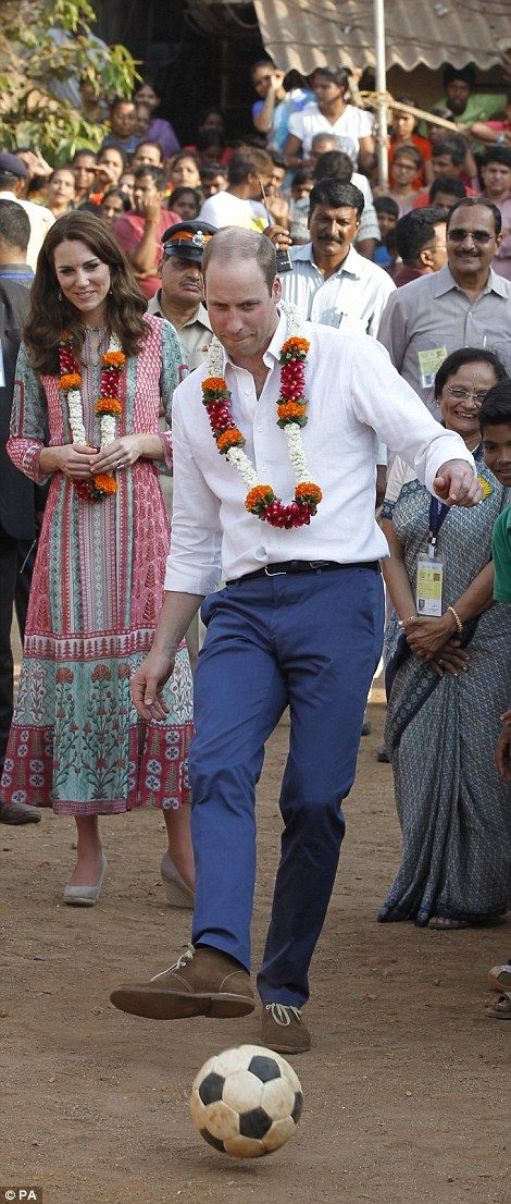 Kick about: Prince William and his wife Kate both showed off their football skills as they kicked a ball around in Mumbai's slums