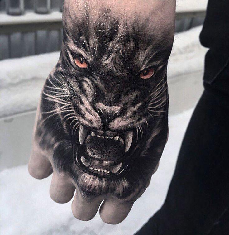 Snarling Tiger Hand Tattoo