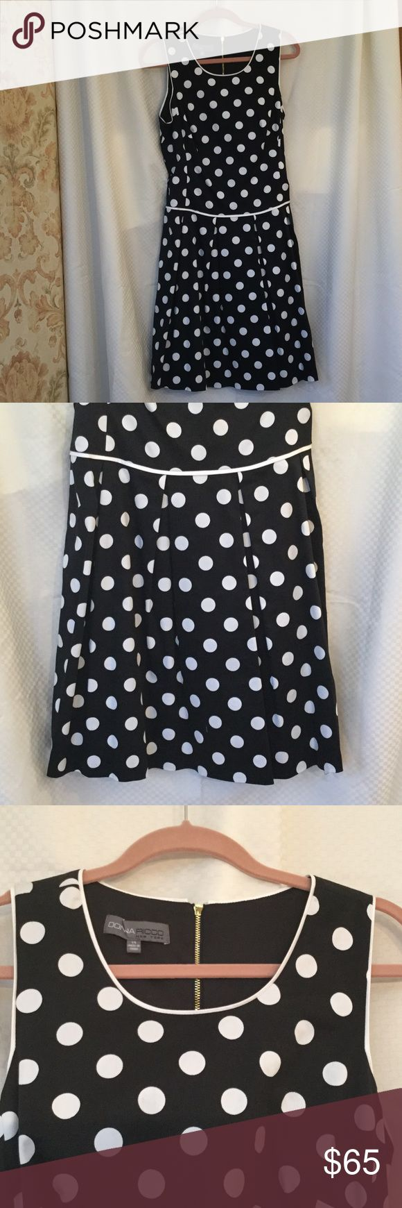 Polka dot dress with pleated bottom Polka Dots and side pockets !! Love pockets !! Cute white piping accents with drop waste for a flattering waste line. Has stretch too !! Bought at a dress altering shop, size says 14 but fits like 8 never picked up by original customer. NNT. Donna Ricco Dresses Midi