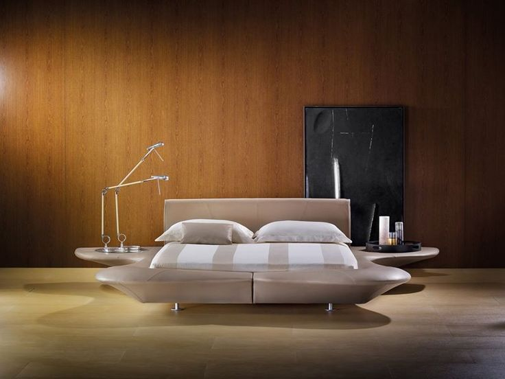Grandpiano is a scenographic double bed that resembles a large platform outlined by a comfortable head-board padded with 'Memoform' and by shaped side panels that can also be used as seating or shelving [Letto matrimoniale / Double Bed GrandPiano by Mario Bellini for Flou]    #Beds #Bedroom #Letto #InteriorDesign #HomeDecor #Design #Arredamento #Furnishings #totalwhite #inspiration