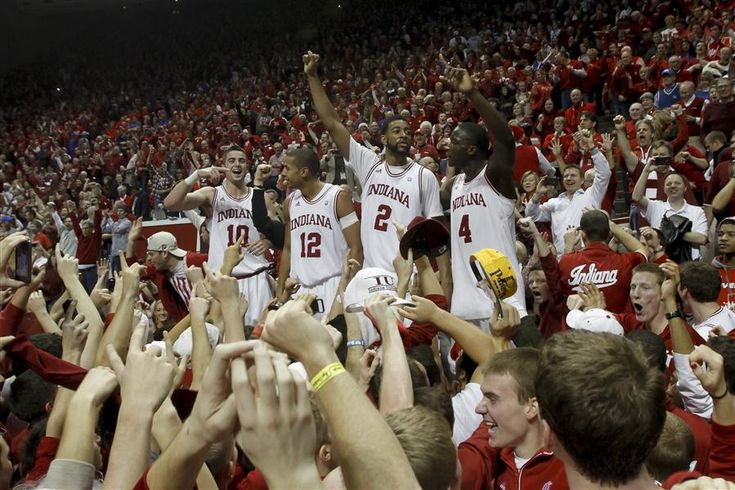 Hoosiers beat Kentucky: IU players Will Sheehey, Verdell Jones III, Christian Watford, and Victor Oladipo (L-R) celebrate with students and fans.