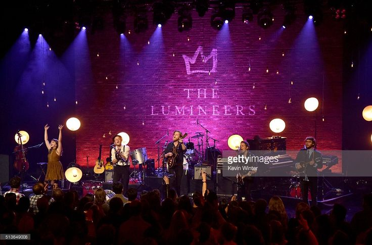 Musicians Neyla Pekarek, Jeremiah Fraites, Wesley Schultz, Byron Isaacs and Stelth Ulvang of The Lumineers perform on the AT&T LIVE stage at the iHeartRadio Theater Los Angeles on March 3, 2016 in Burbank, California.