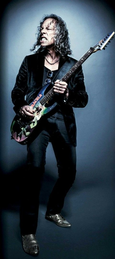 ♥2016♥  Looks like Kirk is wearing a black velvet jacket, with cool shoes and other accoutrements...and his signature ESP Dracula guitar. He does enjoy dressing well