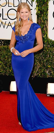 Nancy O'Dell: 2014 Golden Globes Belle in blue! The TV personality stunned in a gorgeous blue gown with ruffles in the back. She paired her outfit with intricate cuff jewelry and earrings.