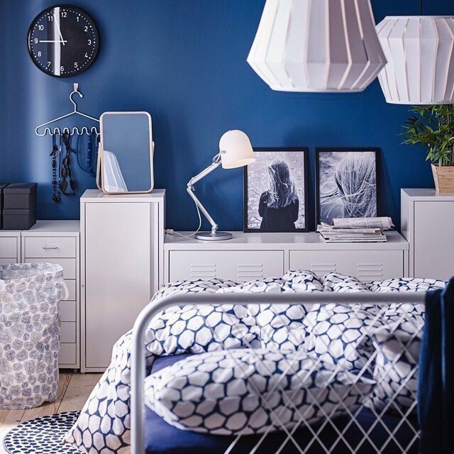 A small bedroom furnished with a bed for two in white metal with ...