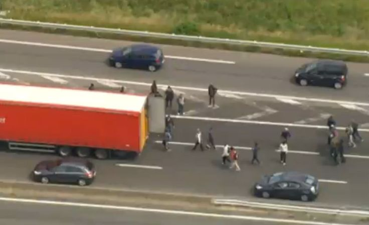 Migrants attempt to board lorries en-route to the UK amid Calais ferry strikes