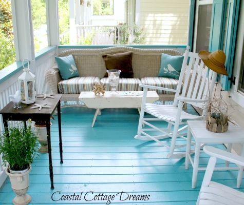Gorgeous beach porch with dreamy turquoise, nice browns and mushrooms, lots of white.  Striped fabric on wicker sofa is perfect.  Would feel cool, calm, and collected here!