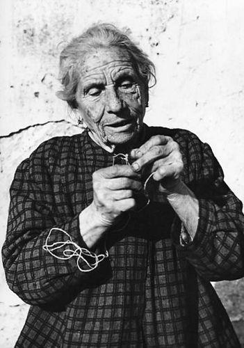 Italy--WW II (1945) elderly Italian lady fiddling with thread or string.      #TuscanyAgriturismoGiratola
