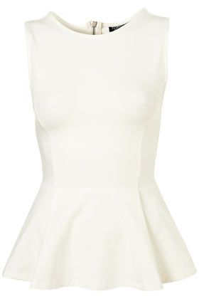 White peplum, wear with a big bold and colorful necklace