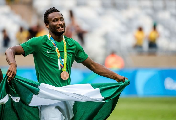 Nigeria's John Obi Mikel celebrates after receiving the bronze medal during the medal ceremony after defeating Honduras in the Rio 2016 Olympic Games men's bronze medal football match at the Mineirao stadium in Belo Horizonte, Brazil, on August 20, 2016.  / AFP / GUSTAVO ANDRADE