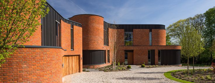 adrian james architects builds sinuous 'incurvo' brick house in rural…