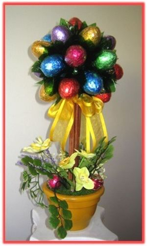 """""""CHOCOLATE TOPIARY"""" - Topiary Tree: This fabulous milk chocolate eggs Topiary Tree will add a festive note to any Easter table, sure to impress any recipient on your Easter holiday list. www.facebook.com/jsluxurybaskets"""
