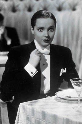 Jessie Matthews in First a Girl (1935) 'passed' as a gay man while projecting an image with lesbian overtones.