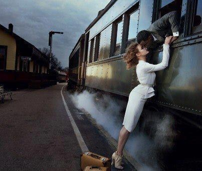 A cute romance novel idea: He gets on the train to leave but gives his love one last kiss.