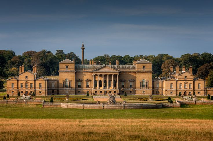 Holkham Hall, Holkham, Norfolk. Constructed in the Palladian style for 1st Earl of Leicester (5th creation) by architect William Kent. One of England's finest examples of the Palladian revival style of architecture, the severity of its design is closer to Palladio's ideals than many of the other numerous Palladian style houses of the period. Formerly known as Neals,  purchased in 1609 by Sir Edward Coke. The ancestral home of the Coke family, the Earls of Leicester of Holkham.