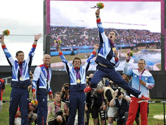 And the whole team... Silver medalists Britain's David Florence and Richard Hounslow, gold medalists Britain's Tim Baillie and Etienne Stott, pose on the podium after the Canoe Double Men's Slalom Final