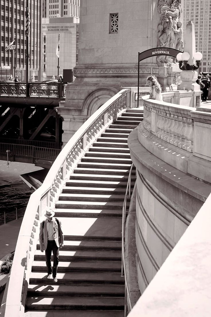 Chicago - The Step Took this photograph overlooking the Chicago Riverwalk. What caught my eye was the lady watching people walking up and down the stairs. I thought the shadow under the man's foot made this photo worth sharing.
