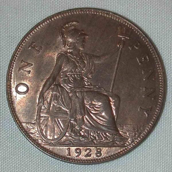 Description: A beautiful lightly toned about uncirculated or better bronze coin from Great Britain. This is the 1928 one penny bronze coin from the United Kingd