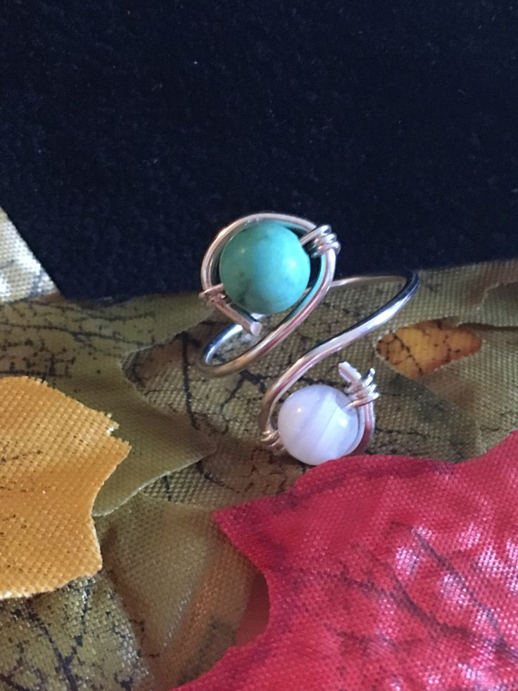 A personal favourite from my Etsy shop https://www.etsy.com/uk/listing/477760752/two-stone-wire-wrap-ring-blue-and-white
