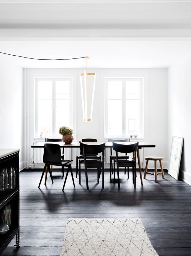 dining room with black floors