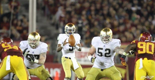 With help from his friends such a Mike Golic Jr. (57) and Braxston Cave (52), quarterback Everett Golson is on the cusp of history as the Notre Dame quarterback.