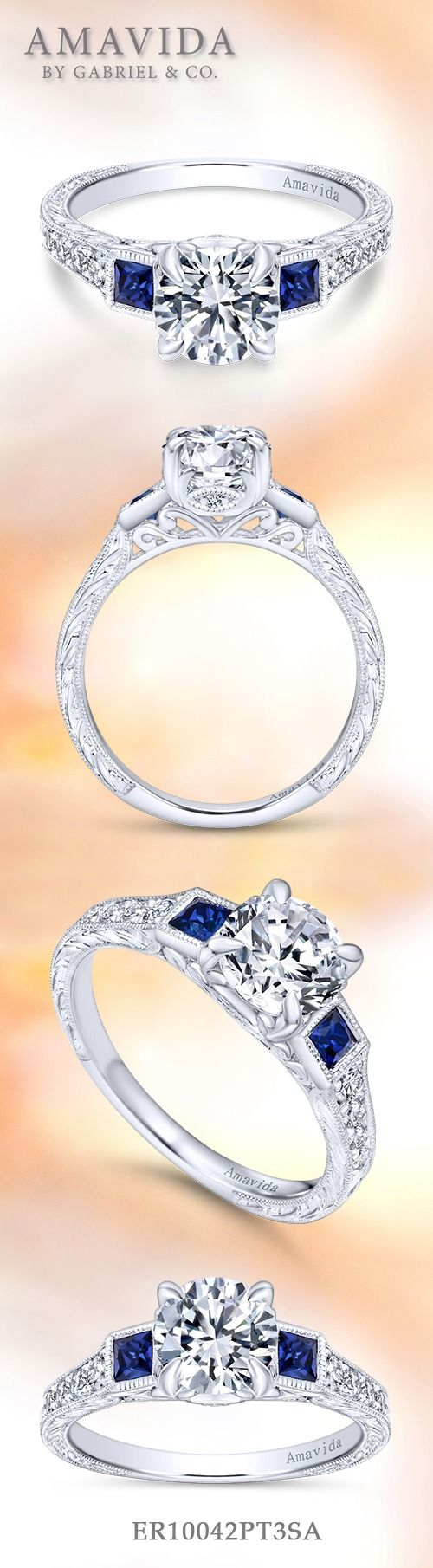 Gabriel & Co.-Voted #1 Most Preferred Fine Jewelry and Bridal Brand.  Glamorous Platinum Round 3 Stones Engagement Ring. Sparkles with a pair of sapphire side stones and a pave diamond band.