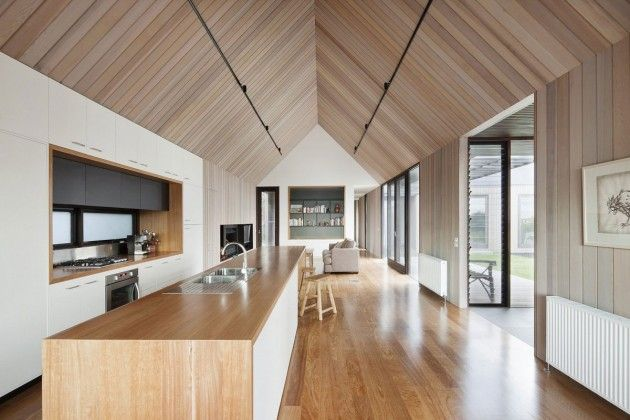 Australian beach home, by Jackson Clements Burrows (I love the galley but open breezeway feel to this space, and the ceiling is gorgeous - could do without the track lighting though)