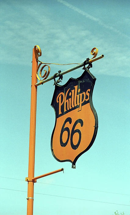 """Phillips 66 on Route 66. Squeaky sign at the restored Phillips 66 gas station on old Rt. 66 in McLean, Texas. """"The Fine Art Photography of Frank Romeo."""""""