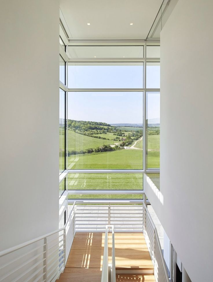 Hickory flooring adds a hint of warmth to the white spaces of this house designed by Richard Meier & Partners