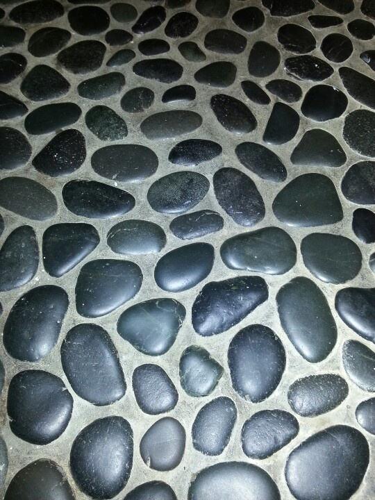 dark grey pebble floor for master shower with dark grout, prefer closer placement of pebbles