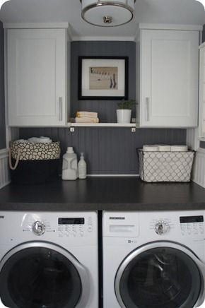 easy remodel for laundry room...put in two cabinets, a shelf in between, and lay a piece of painted wood over top the washer and dryer. Allows for more space and more appealing to the eye.