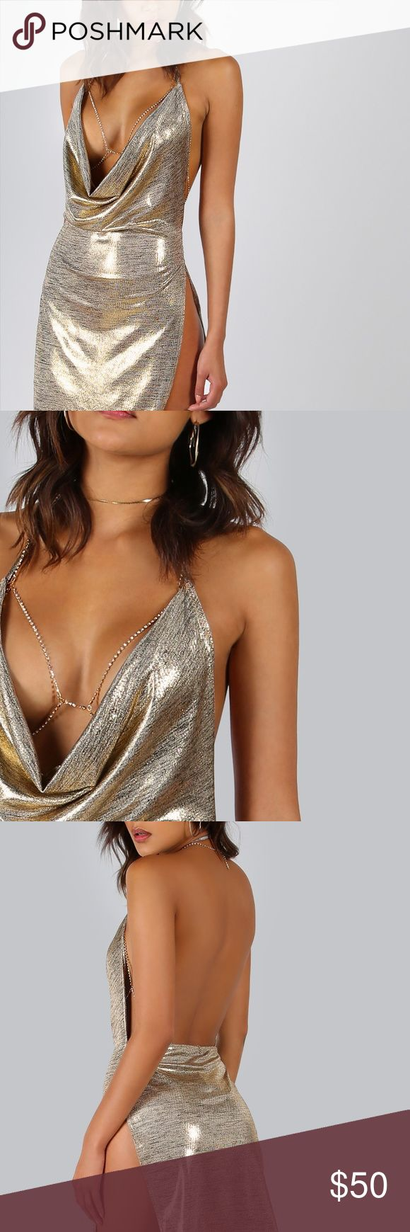 Sexy mini dress Very sexy metallic mini dress with slit on side. This dress features a thin cozy material but not see through and a plunging v-neck very comfy & stretchy 94% polyester 6% spandex body jewelry is not included. Dresses Mini
