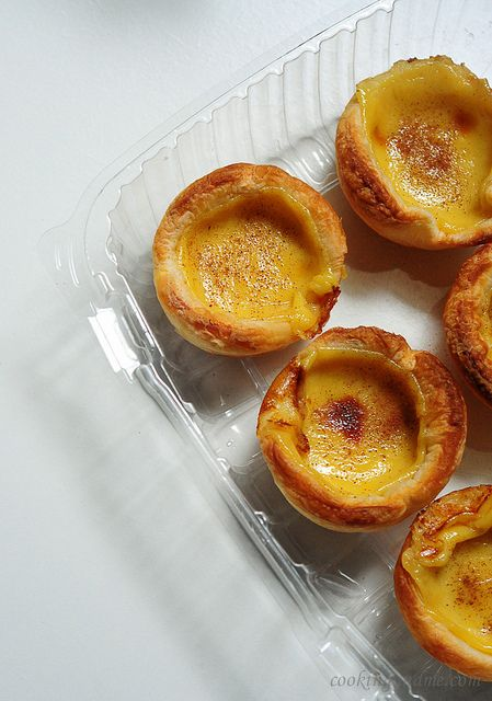 Portuguese Egg Custard Tarts  Adapted from Not Quite Nigella  Makes 12    Ingredients:  3 egg yolks  1/2 cup sugar (I would use slightly lesser than this next time)  2 tbsp cornflour  400ml full cream milk  2 tsp vanilla extract  1 block of puff pastry sheet