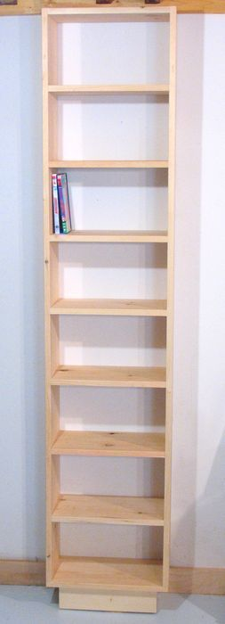 Use light wood bookshelf on thermostat wall for DVDs - add extra shelves from Violet's