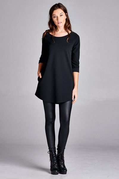 Amazing soft crepe tunic in Black. Two front pockets with 3/4 sleeves. Pullover style. This tunic looks amazing with leggings, and is great to dress up or down. Poly blend. Model is wearing a Small. S