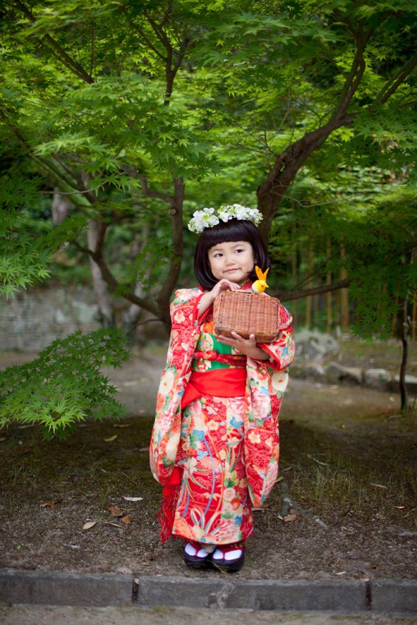 Here is a little girl dressed in a traditional kimono.