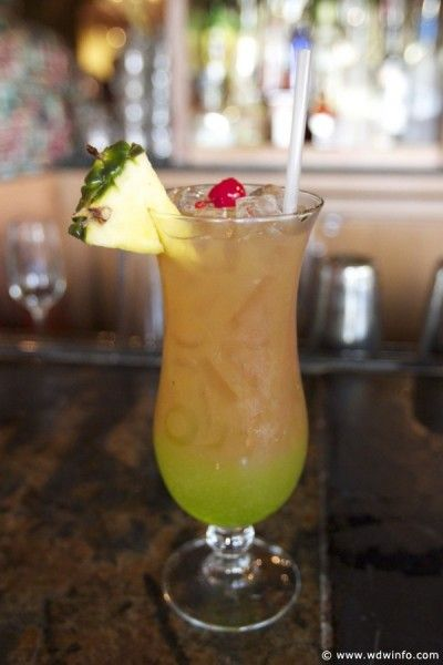 Tropical Macaw  (1 part Parrot Bay coconut rum, 1 part Midori melon liqueur, 2 parts pineapple juice, 2 parts cranberry juice)