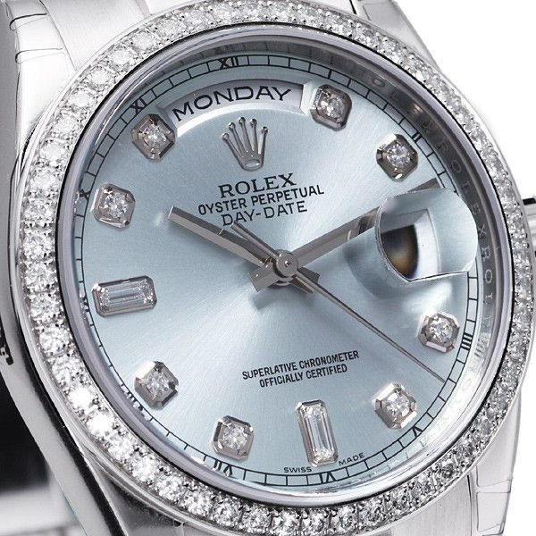 - Model Number: 118346 - Gender: Mens - Condition: Unworn with Box & Papers - 2014 Model - Dial Color: Ice Blue with 8 rounds and 2 baguettes - Movement: Self-Winding Chronometer Movement - Crystal: S