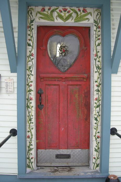 Red door with patterned trim.