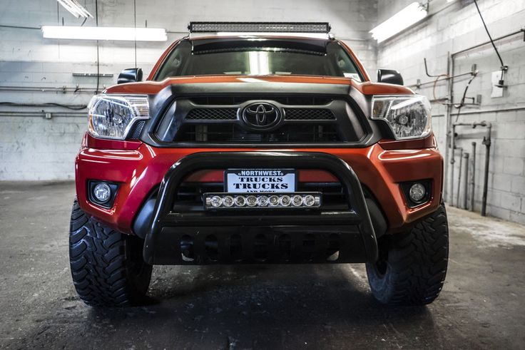 Used 2014 Toyota Tacoma TRD Off Road 4x4 with 20,786 at Northwest Motorsport in Puyallup, WA. Buy a used Red Toyota Tacoma.