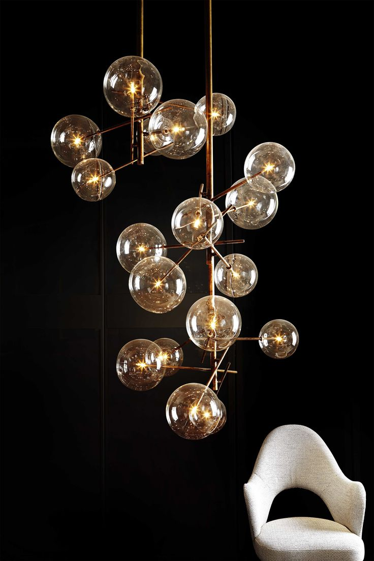 Gallotti & Radice -  Bolle Pendant. Hanging lamp with halogen point light (120 Watt). 6 transparent blown glass spheres. Available also version with 4 spheres (80 Watt). Metal parts in hand burnished brass.The hand burnished brass finish looks naturally spotted and irregular. Due to this craft made processing, each product is unique and exclusive. Dimmable light. The height can be customised from a minimum of 85cm (Bolle 6) and 73 cm(Bolle 4) to a maximum of 600 cm (including lights). LED…