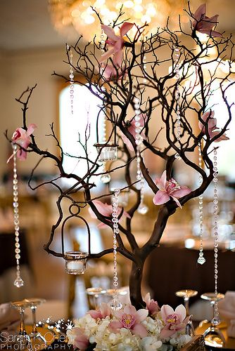 Manzanita branch with candles hanging and flowers on branches. Flowers should be a deep red color or burnt orange.