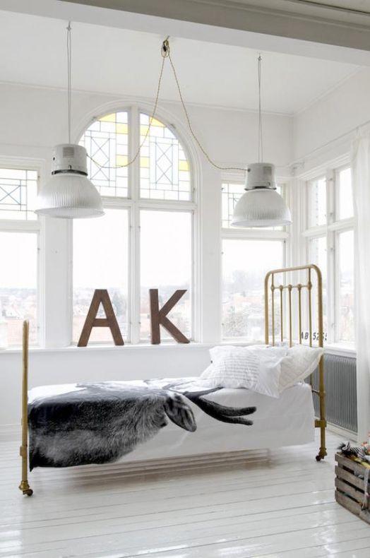 Scandinavian bedroom - industrial lights, stained glass windows, typography, deer bedlinen