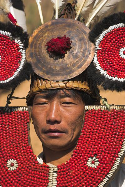 Myanmar (Burma), Sagaing Region, Lahe village, Naga New Year Festival, Naga man, Taungkul tribe wearing traditional headdress   © Jon Arnold Images
