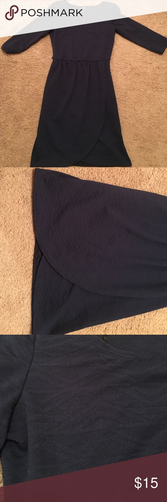 Long sleeve navy dress I.N. navy dress made of a thin quilted material with discreet triangular horizontal patterns. The middle is cinched and looks great with a thin belt. The bottom separates into two overlapping flaps. I.N. San Francisco  Dresses Long Sleeve