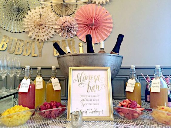 Sparkly mimosa bar at a pink and gold bridal shower party! See more party planning ideas at CatchMyParty.com!