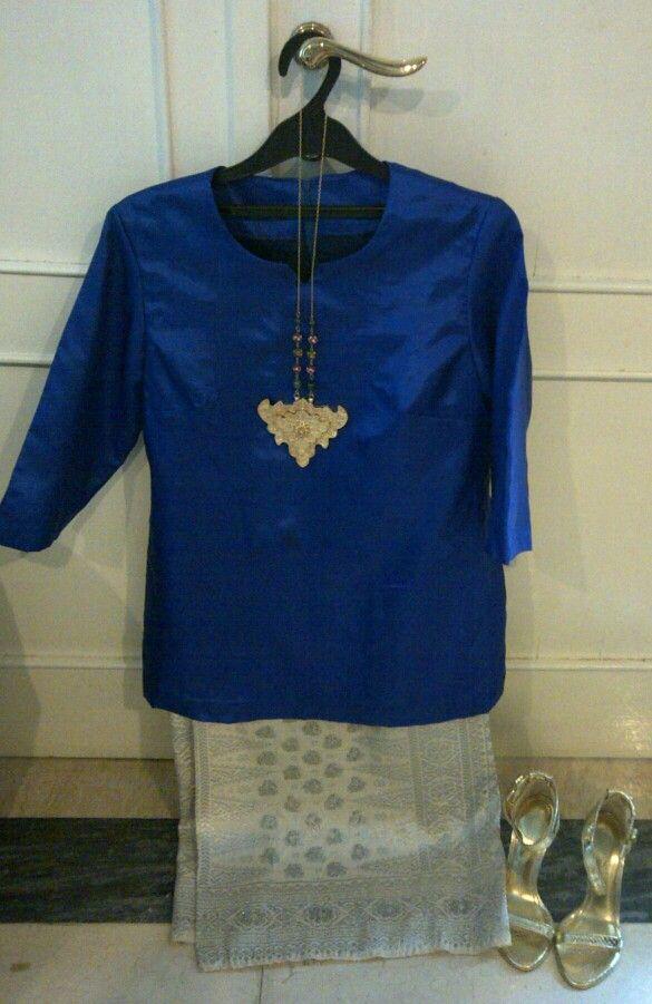 Baju kurung_songket: combination of silver and gold