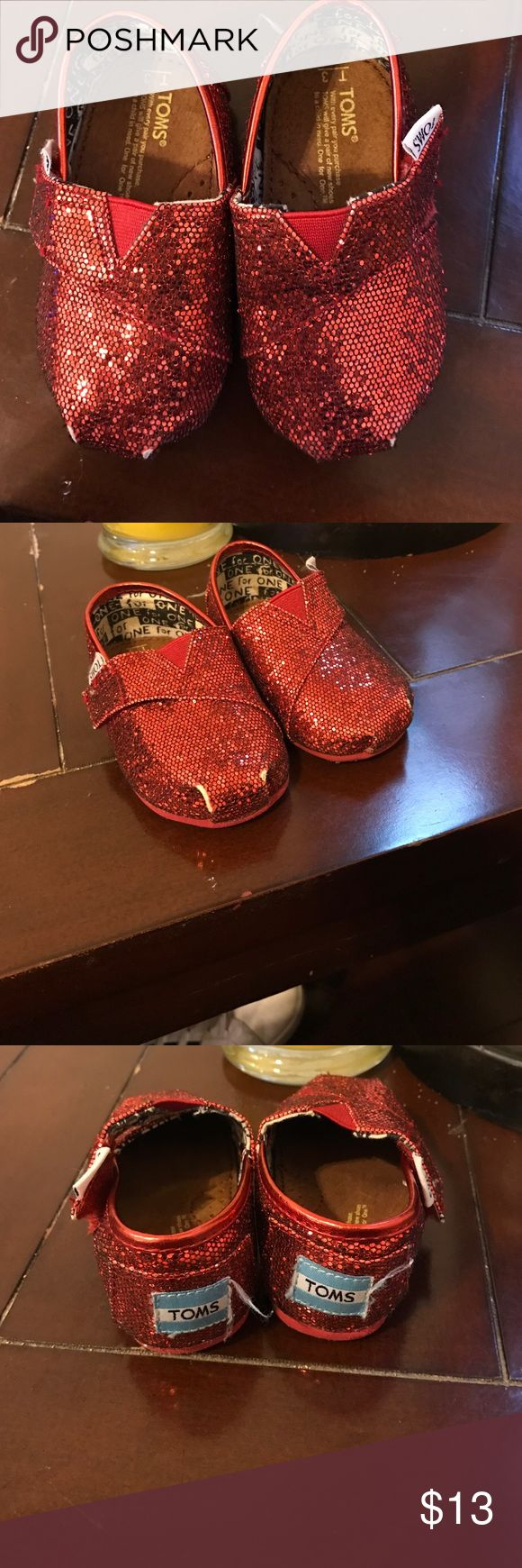 Toddler toms Used good condition, some nicks on the top of shoe which I have pictured . Clean . TOMS Shoes Slippers