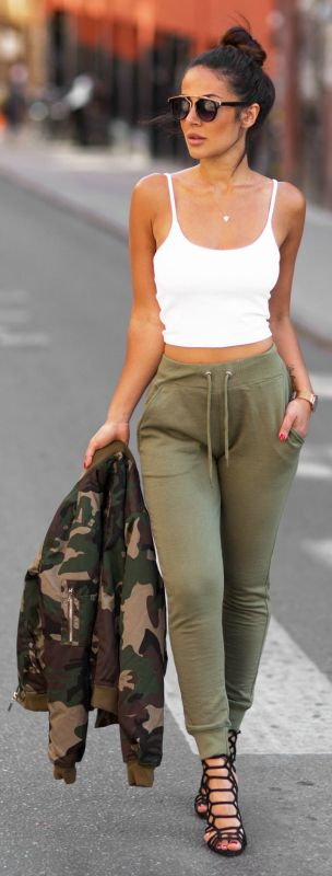 Sharareh Sophia Hosseini + simple but effective choice to wear joggers + crop top + easy summer style + coordinated colours of this outfit + camouflage jacket + adds another element      Joggers/Jacket: Missguided, Top: Bikbok, Shoes: Steve Madden.