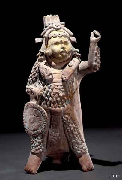 Maya Warrior  Description:  Maya. Jaina. whistle. height 25.4 cm. Warrior wearing cotton armor. He carries a battle standard